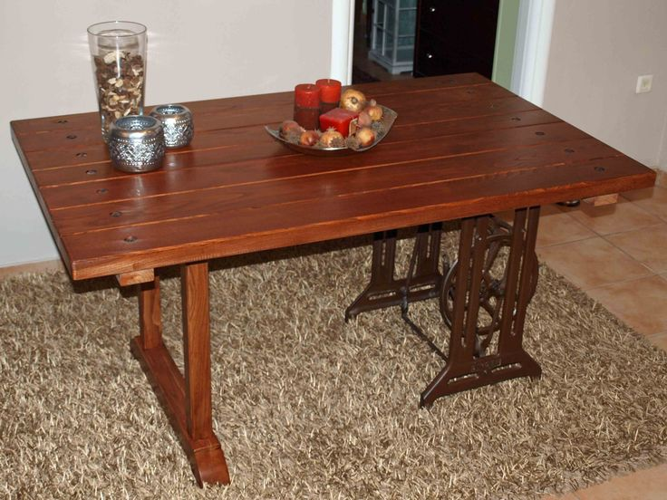 dinner table from chestnut wood and a Singer sewing machine base