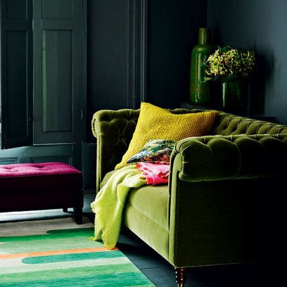 """The key to harmonising different shades of the same colour is to keep to the same under tone. In this case, all the greens, from the darkest myrtle on the walls and shutters to the softest olive on the velvet sofa, share an element of yellow. The mustard pulls the look together and gives the room wonderful shaft of sunlight. Add a pop of contrasting colour such as this hot pink."""