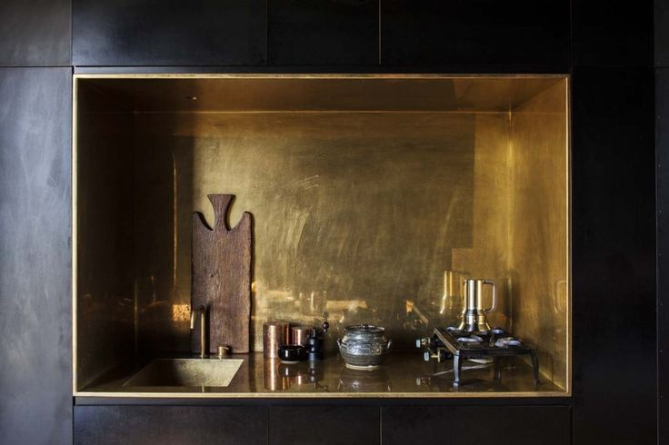 In the black cabin, the kitchen is a small brass inset. Photograph by Darryl Ward.