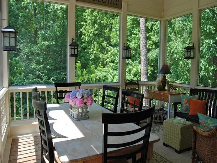 Love the lanterns on the posts. 18 Photos of the Decorating Screened Porch Furniture Ideas- lanterns/ separate sitting vs table area