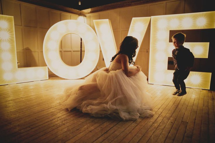 Large light up LOVE letters | Photography by http://helenrussellphotography.co.uk/