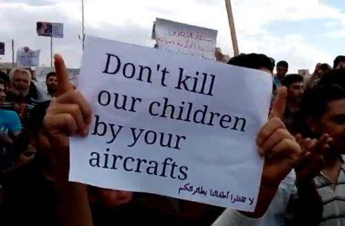 Parents in Syria protesting the american government's bombings.
