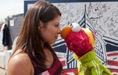 Caption contest: Elmo, Olympic boxer face off