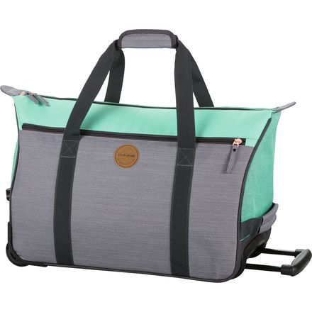 """So you're wearing sweatpants, your hair is disheveled, and you're starting to feel the after-effects of """"Margarita Monday"""" from last night. At least your luggage will look stylish when you travel with the Dakine Carry On Valise Women's Duffel Bag. It has the look of a chic tote bag, but boasts a retractable handle and wheels so you don't have to carry it as you shuffle begrudgingly to your terminal."""