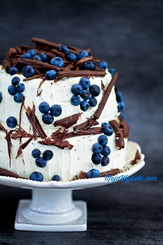 Cake styling with blueberries and chocolate.