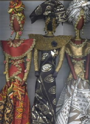 Three Queens,  One-of-a-kind handmade cloth doll, adorned in recycled leather, embellished with beads.