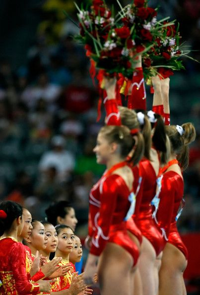 The Chinese women's gymnastics team watch as the United States team celebrate their silver medal in the artistic gymnastics team event at the National Indoor Stadium during Day 5 of the Beijing 2008 Olympic Games on August 13, 2008 in Beijing, China.