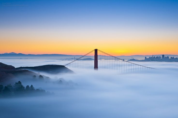 Waiting for the Sun by Joe Azure.The North tower of the Golden Gate Bridge as the sun get ready to pop up over the East Bay hills.