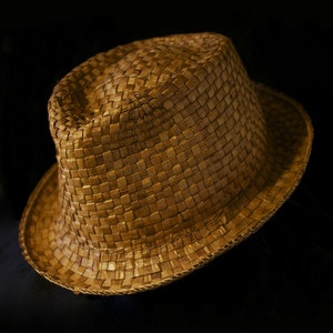 "This Fedora varied dye hat was designed and handwoven by Paul Rowley (Tlingit/Haida). It measures 23 1/4""    Rowley weaves both contemporary and traditional cedar bark hats. He has been mostly self-taught and strives to make wearable art which reflects the rich traditions of the Pacific Northwest's tribal history."