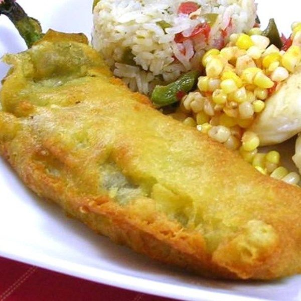"Chile Rellenos | ""Delicious green chiles stuffed with cheese, dipped in a special batter and fried in canola oil."""