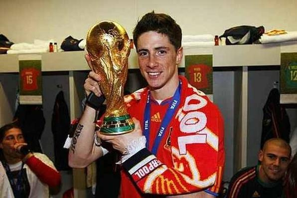 Having scored the winning goal in the Euro 2008 final, Fernando Torres is pictured in a Liverpool scarf after helping Spain win the World Cup in South Africa