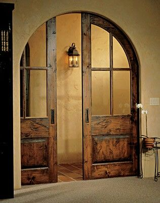 Pocket doors, or archway.  but both is lovely.