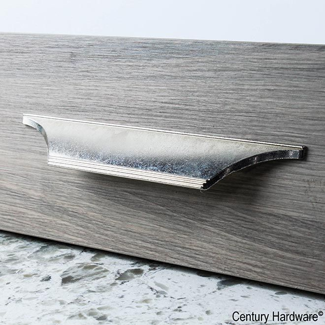 This polished nickel aged finish cabinet edge pull features a rustic design and is a part of the Marquise Series from Century Hardware and is Perfect for use on cabinet doors and drawers capable of accepting a back mounted pull.