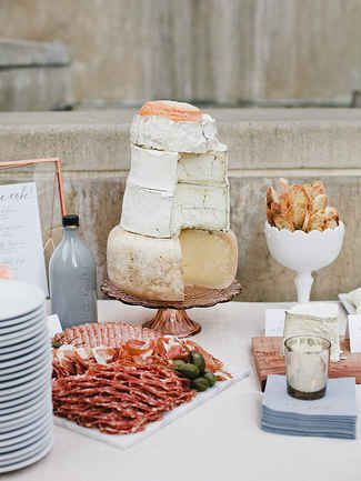 Ok, so maybe a cake made from wheels of cheese isn't going to replace traditional wedding cake, but it's perfect for a creative pre-reception wine and cheese hour. Imagine each layer is a different cheese flavor like creamy goat cheese, smoky gouda or sharp cheddar with meats and crispy bread on the side.