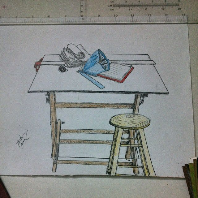 my desk pen and colored pencils