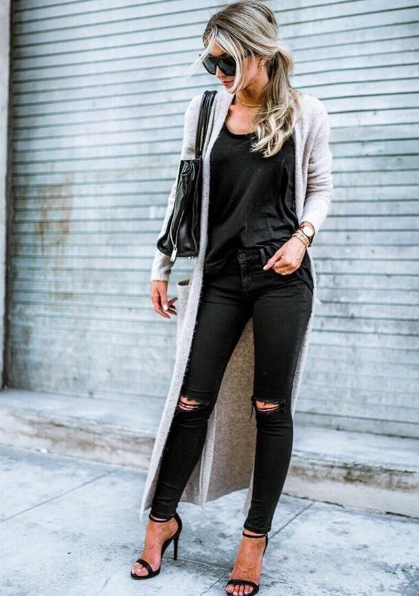 There's a good reason that black is every fashionista's standard wardrobe color palette - it's undeniably chic and oh so trendy. Layer a long cardigan over it, and you're all set to go.