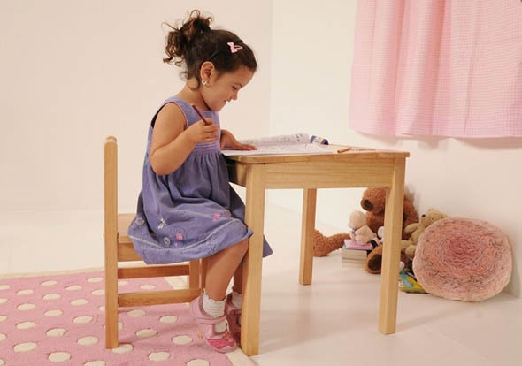 If you're looking a for a traditional style kid's desk then the Natural Desk and Chair from Kid's Room  is a solid wood desk and chair with a handy shelf and slide-out drawer.