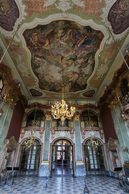 7 Maximilliansaal, looking to the glass doors which open to the main corridor and the grand staircase. The floor above also has glass doors (and a railing.) The burgundy areas above the side doors once held allegorical oil paintings. The soviets took them and lost them without trace. This is a  great shot of the rococo ceiling. JC