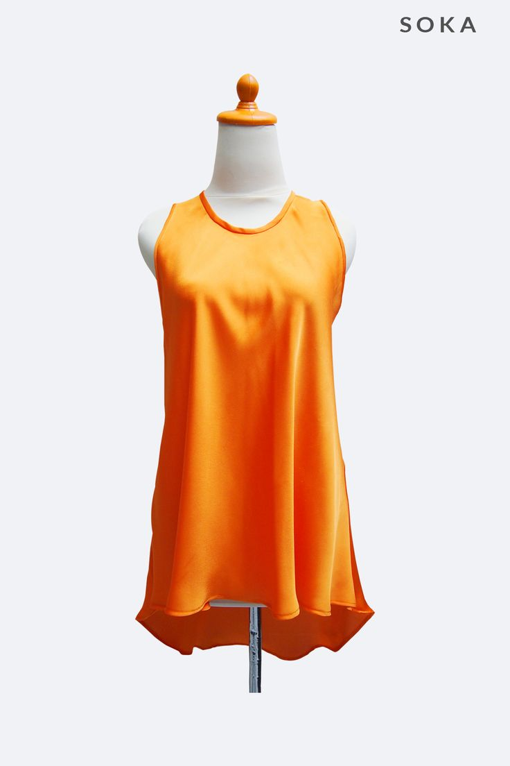 Orange sleeveless women blouse, perfect to be combined with mini skirt or jeans, for daily street wear. If you love to dress up casually, this orange blouse can be a good choice.
