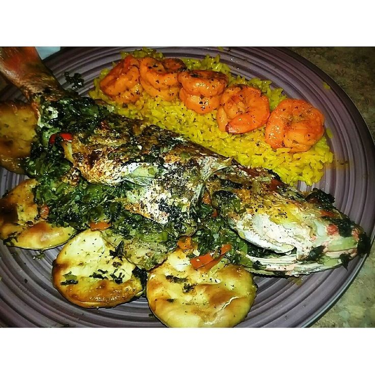 Stuffed fish kinda night  RED SNAPPER STUFFED WITH OKRA CALLALOO SCOTCH BONNET PEPPERS  RED BELL PEPPERS  WITH YELLOW RICE AND SHRIMP  #goodeats #foodporn #stuffedfish  #caribbeancuisine #jamaicanfood  #seafood #homecooking#dinner  #bountiful #chef by kandi_montana