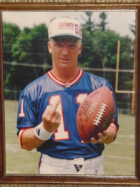 "A unique ""Last Year Player Photo"" of former NY Giants Quarterback Phil Simms. Shortly after this photo was printed the negatives were confiscated by Simms."