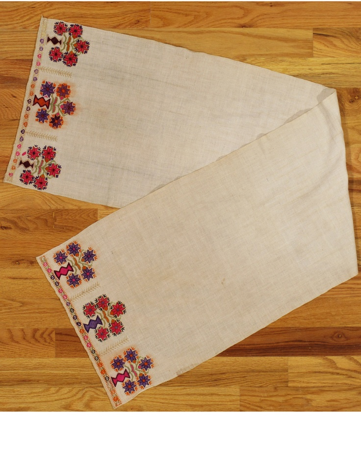 Ottoman textile,Western Anatolia,circa 1880.Measurements of the piece:4.1x1.1 (124x33 cm).Silk embroidery on linen with three vases and flowering bouquets at each end.The center is plain and the orange is synthetic.This piece was used as a hand towel in a household.The condition is good.