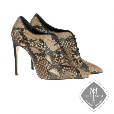 FERI MOSH - Liliana Oxford - Stilettos    Price                                  $2,826 Canadian Dollars Product #                           FMLS-5312 Product Category              FERI MOSH Opulence Wear - Light brown genuine python oxford stiletto heels  - Made with genuine python uppers and lined with nappa leather and suede  - Real leather sole  - Quality stacked wood heel  - Metal plate with FERI MOSH logo on the outer side of both shoes - Lace up, oxford design  - FERI MOSH logo…