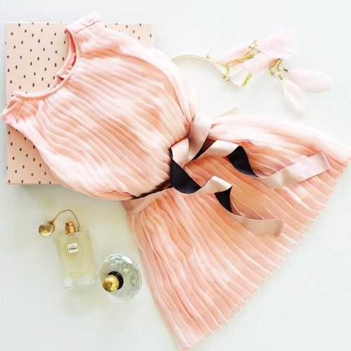 Children's fashion flatlay, styled by Madeleine Theodore. Gumboots pink dress available at David Jones.