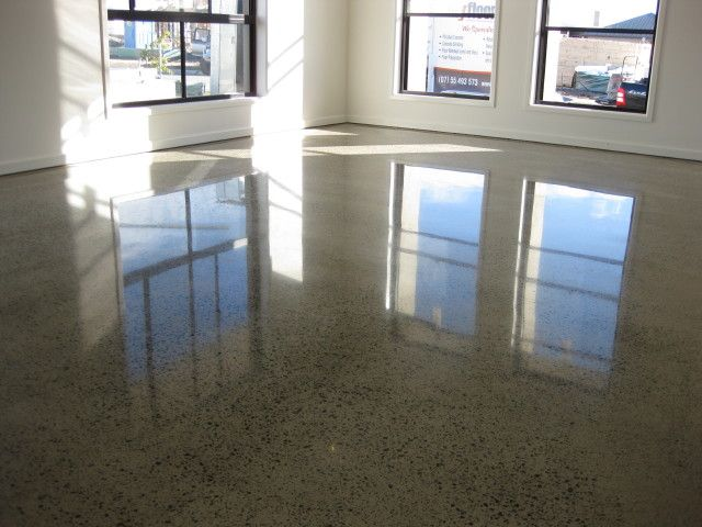 For lack of a better word, I'm obsessed with level floors and keeping them clean (visibly and tangibly), so classic diamond-polished concrete is one of my favorite things. They're low-maintenance and become very cost-effective over the lifetime of the floors. Throw in some radiant heating and not even the old lady can complain!