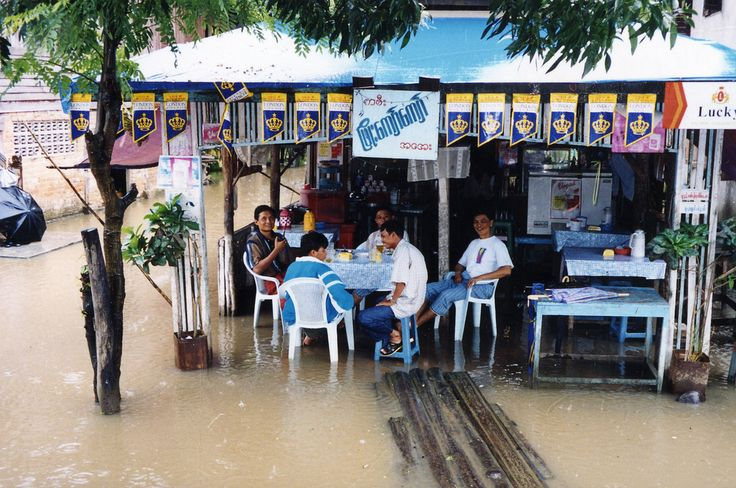 Dining in a flood, Myawaddy, Myanmar / Burma   by Boonlong1