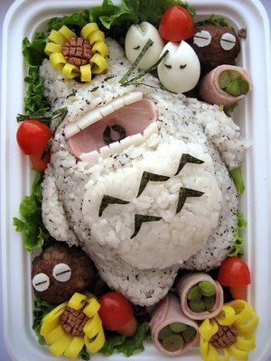 cat out of sushi and rice.........at least i think its a cat?!