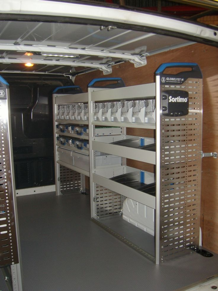 Ford Transit SWB LR RWD - Offside and nearside Sortimo racking system with slide out vice holder