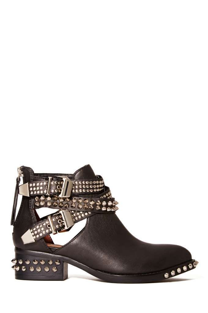 This is your basic black boot turned up a notch! These awesome black leather ankle boots feature silver stud and spike detailing, side cutouts, and strapped detailing with buckle closures.