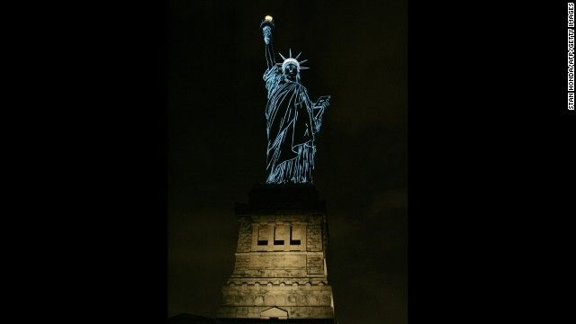 During a special 2006 show by French champagne maker Moët & Chandon, the Statue of Liberty is lit to show the contours of the sculpture.