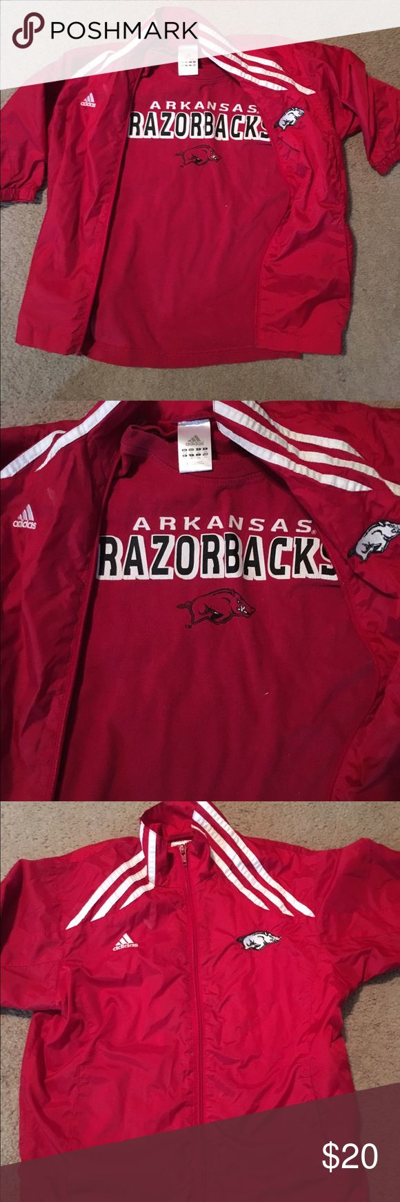 Arkansas Razorback wind breaker and shirt Arkansas razorback a zip up and shirt both are included in this bundle lightly worn on the T-shirt the tag is torn off size 6 jacket and I believe size 6/7 shirt both in good condition Matching Sets