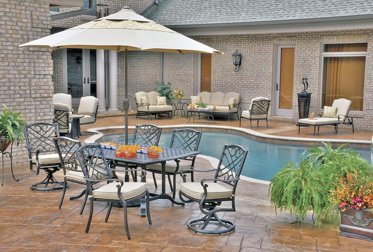 Antibes Dining Set Made Of Cast Aluminum With Phifer Fabric Cushions.  Available At Hicks Nurseries
