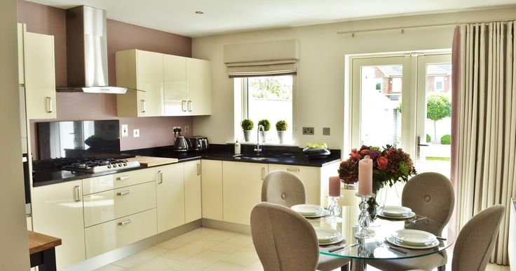 My kitchen; cream high gloss with granite worktops. Circular glass table with fabric chairs.