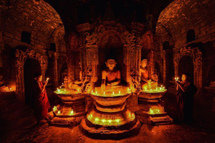 Mrauk-u Myanmar - Novice monks in the plain of mrauk-u Ratanabon Paya on candle light at night,Mrauk-u Myanmar,Myanmar culture,myanmar ancient,
