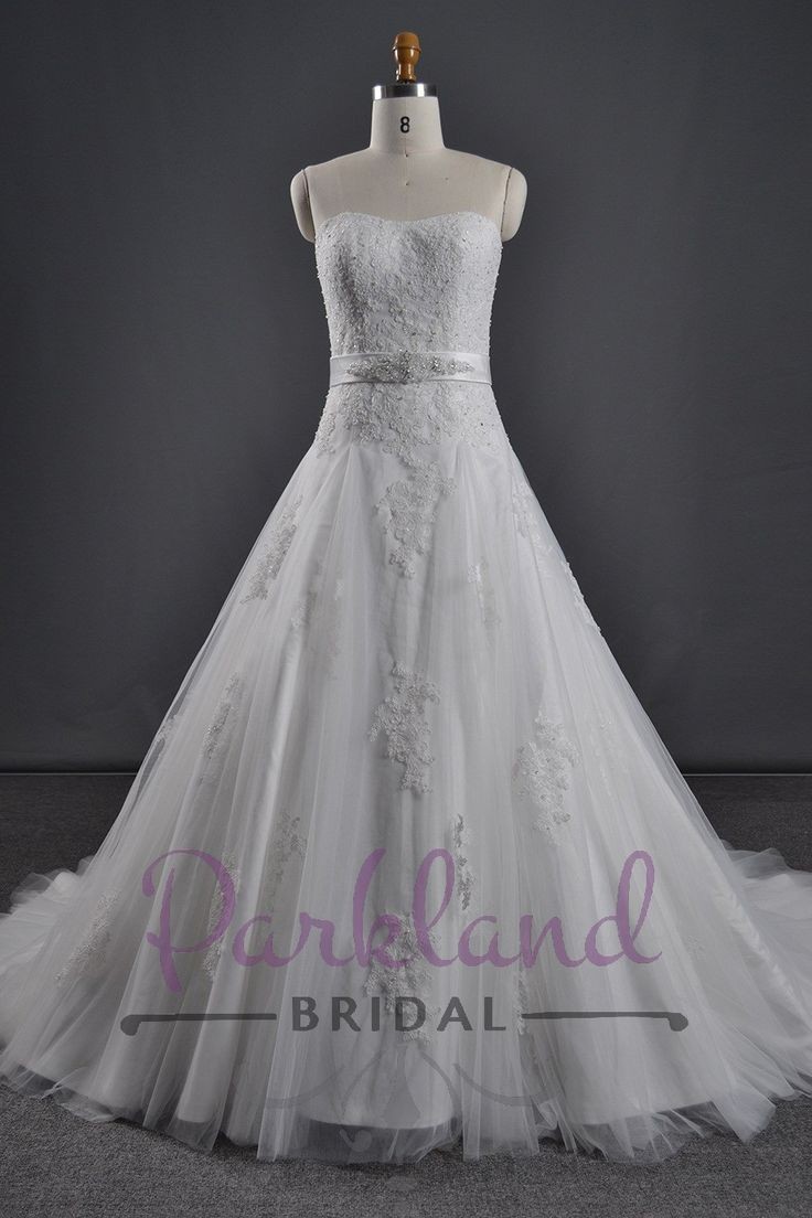 A beautiful strapless tulle A-line gown embellished with gorgeous lace. Features a stunning luxury beaded sash at the waist. http://www.parklandbridal.co.nz/Store/tabid/4393/ProdID/34769/CatID/358/Parkland_Bridal_Alana.aspx