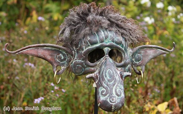 Arvid the Young Troll - The troll mask is 100 % hand-made and hand-shaped of vegetable tanned leather. The other materials are grain color, acrylic paint, cow teeth, butyric acid tanned sheepskin and brass rings in the ears.