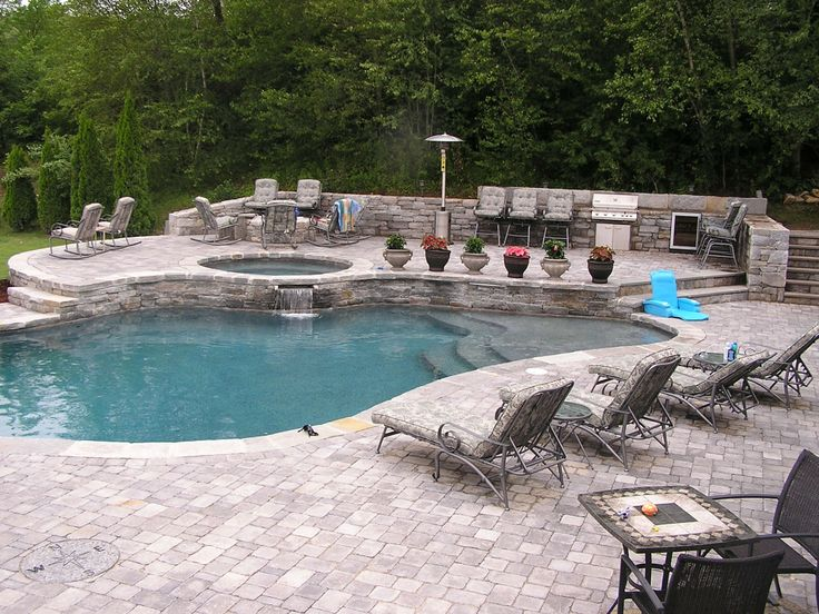 pavers and natural stone combine seamlessly in this stepped pool
