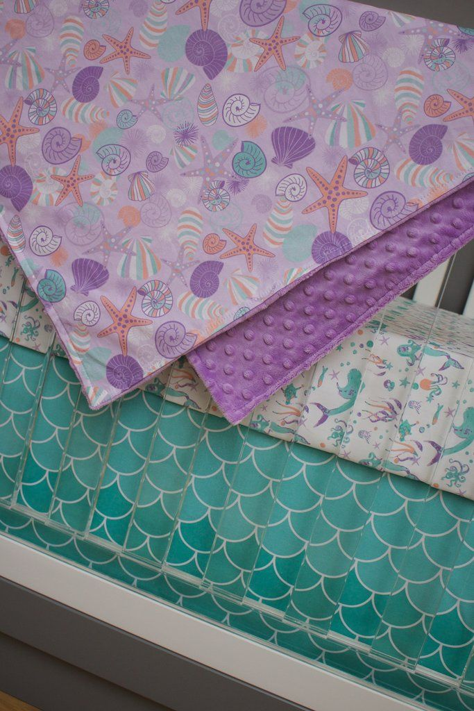 Browsing for girl nursery themes? This mermaid crib bedding is one of our top sellers! We love the mix of purple, mint and turquoise for your nautical baby nursery. Crib Bedding Details: - Fitted crib
