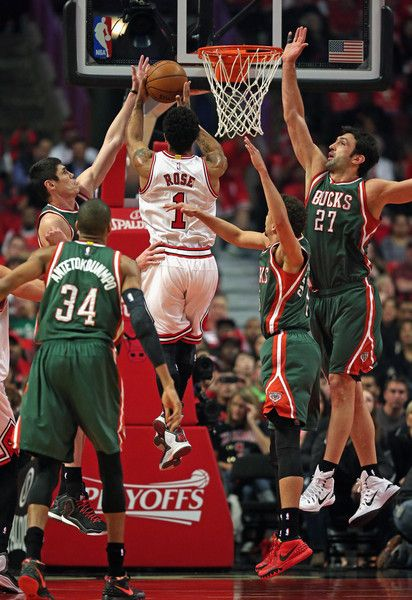 Derrick Rose #1 of the Chicago Bulls drives into (L-R) Giannis Antetokounmpo #34 , Ersan Ilyasova #7 , Michael Carter-Williams #5 and Zaza Pachulia #27 of the Milwaukee Bucks during the first round of the 2015 NBA Playoffs at the United Center on April 27, 2015 in Chicago, Illinois. NOTE TO USER: User expressly acknowledges and agress that, by downloading and or using the photograph, User is consenting to the terms and conditions of the Getty Images License Agreement.