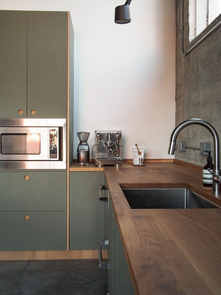 Reform's Basis Linoleum kitchen design in 'Olive' with oak. It's an IKEA hack.