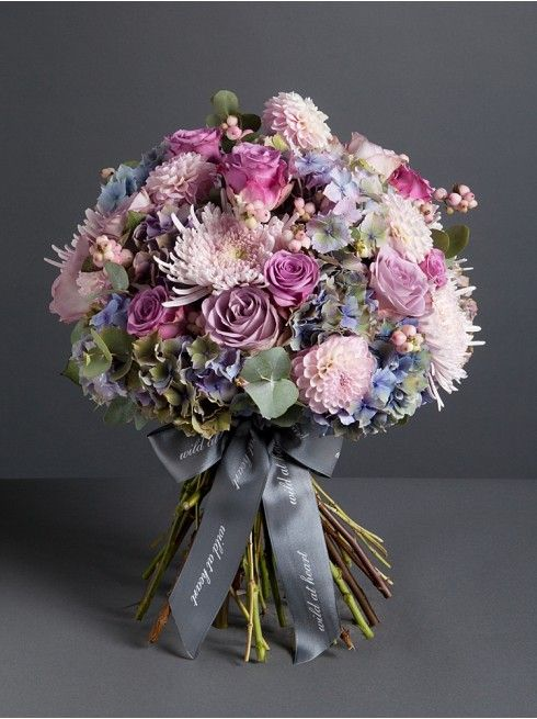 Wild At Heart - Summer meadow bouquet  - This soft, vintage styled bouquet comprises seasonal blooms, hydrangea, roses and pink snowberries for a gentle bouquet that brings a piece of an English summer meadow into your home.