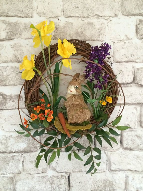 Spring Wreath / Easter Bunny Wreath / Easter Wreath / Door Wreath / Etsy - This beautiful, silk floral, bunny wreath was handmade using a natural 18 circular grapevine wreath adorned with lovely yellow, orange and purple silk flowers, greenery, dried mushrooms, and an adorable straw bunny with a carrot. Individual swirling vines of natural grapevine were added to give this wreath a woodsy feel, and to provide depth and character. This is such a charming wreath that can be displayed on your…
