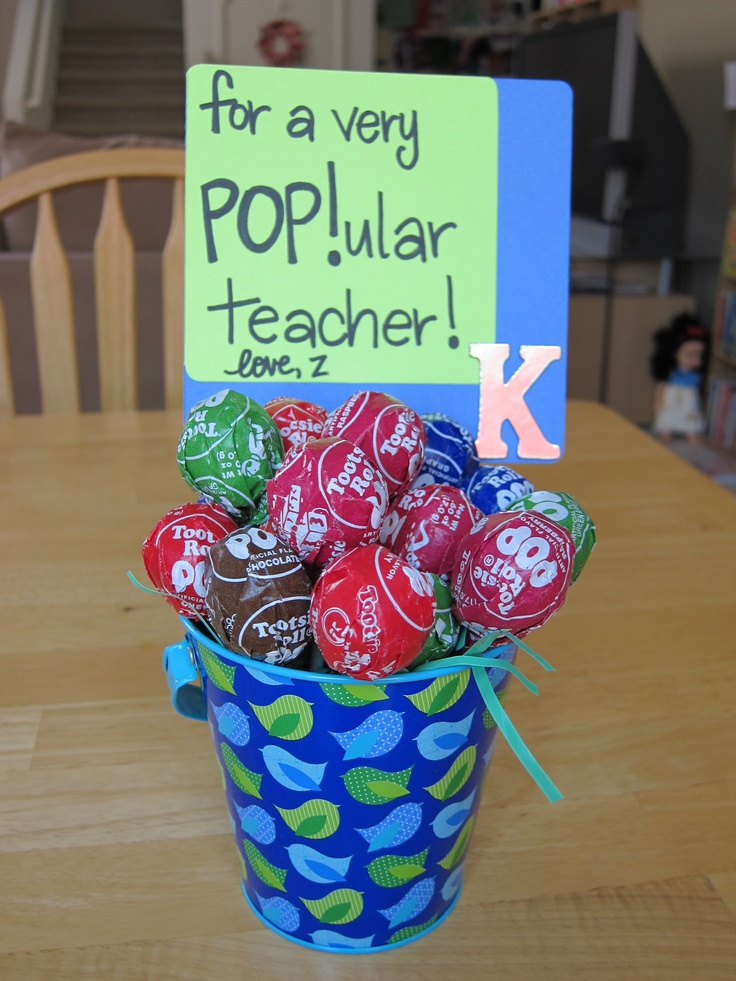 Made this for our preschool aide. Total cost: $3.50!  Target dollar section pail & a bag of Tootsie Pops.  Used left over Easter grass for filler and hot glued the sign to a lollipop stick.  (Inspired by the Teacher Popcorn Gift at crystalandcomp.com)