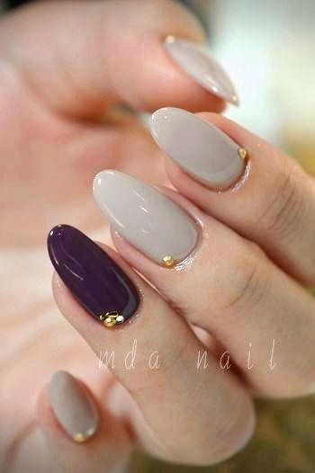 Grey and burgundy nails. I love the little placements of the studs