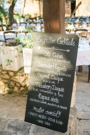 Cocktail menu chalk board sign for fun-filled wedding reception at traditional private estate in Crete. Moments www.weddingincrete.com