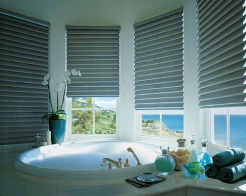 Out of the Dark: 10 Updated Classic Roman Shades -turquoise roman shades by hunter douglas